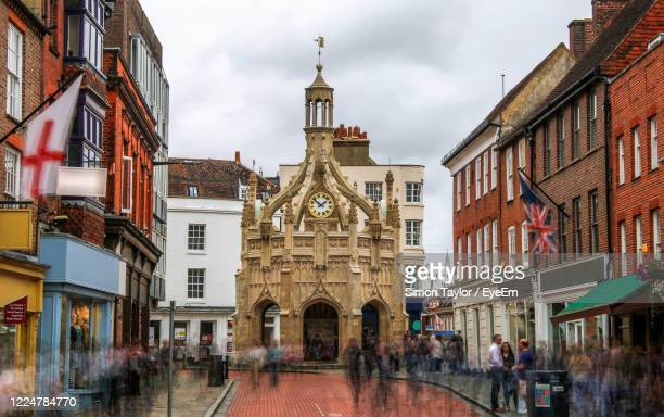 view of historical building in city chichester - chichester stock pictures, royalty-free photos & images