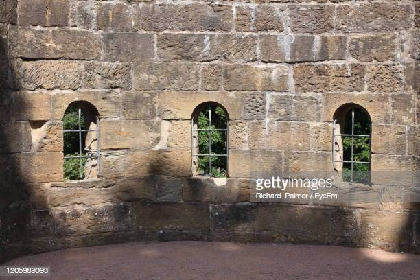 view of historical building - stone wall stock pictures, royalty-free photos & images