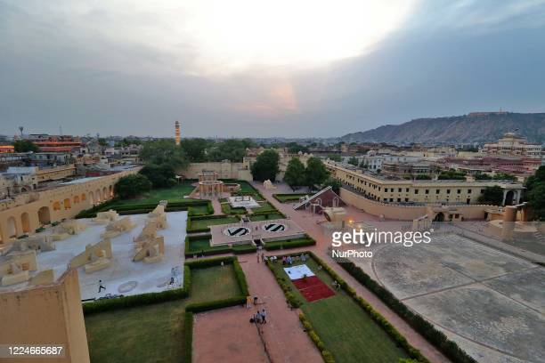 View of historical Jantar Mantar while Astrologers and Scholars worship the flag and forecasting the air quality testing during the sunset ahead the...