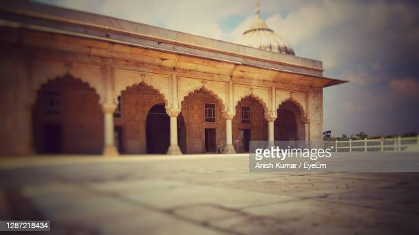 view of historical red fort building in white - arch stock pictures, royalty-free photos & images
