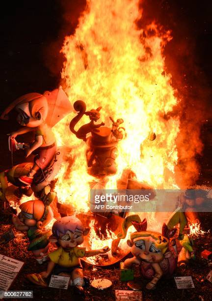 View of 'hogueras' burning on the last night of the annual San Juan celebrations in Alicante Spain on June 24 2017 Fires are lit throughout Spain for...
