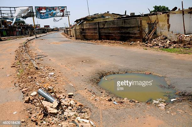 A view of hole and a burnt wall at the site of the May 202014 twin car bombings carried out by Islamist Boko Haram insurgents near the Terminus...