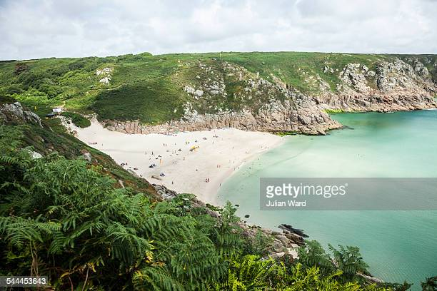View of holiday makers on beach, Porthcurno, Cornwall, UK