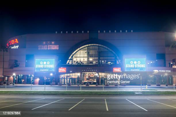"""View of Honda Center with illuminated blue signs reading """"STAND STRONG #lLightItBlue"""" on April 16, 2020 in Anaheim, California. Landmarks and..."""