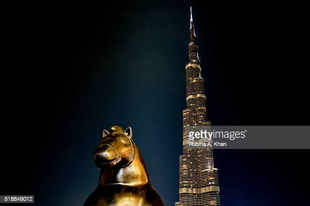 A view of Horse a bronze sculpture weighing 15 tonnes by Colombian figurative artist Fernando Botero alongside the imposing Burj Khalifa on April 2...