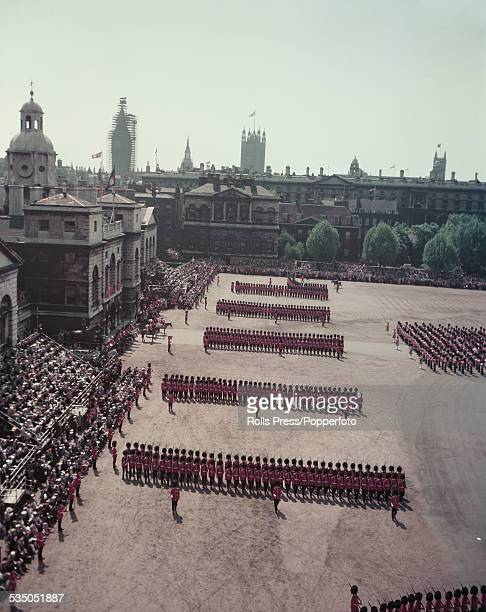 View of Horse Guards Parade with regiments of British Army guardsmen marching in line before an inspection by Queen Elizabeth II during the Trooping...