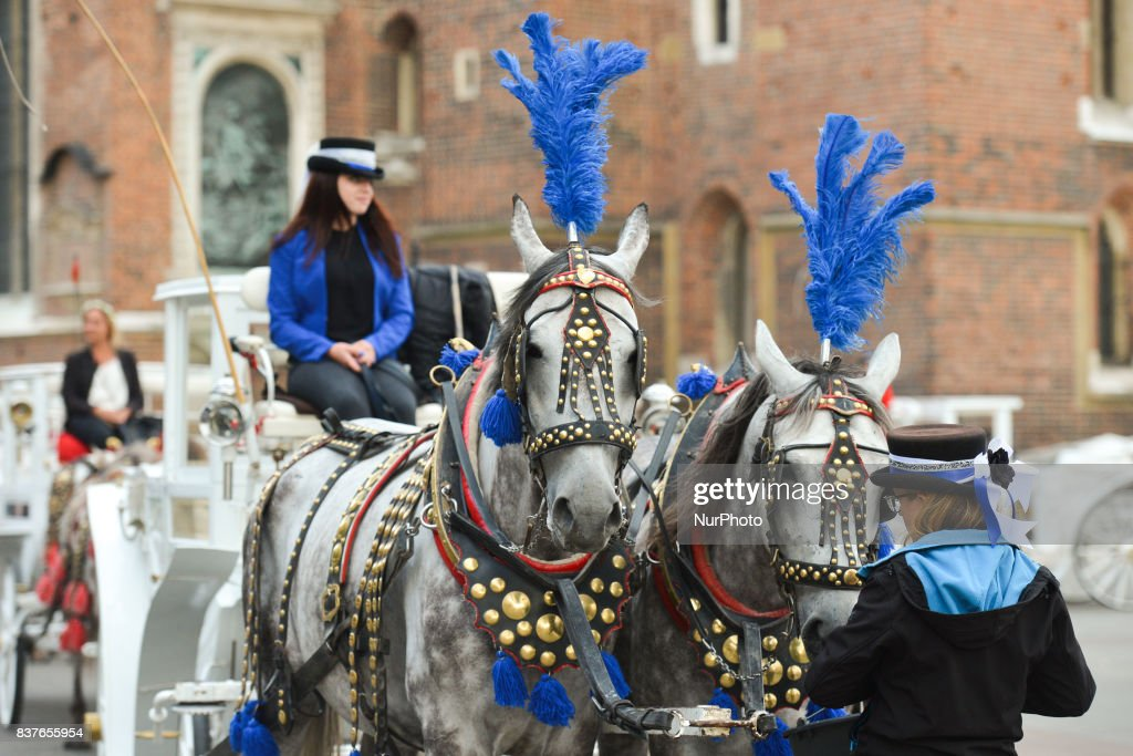 A view of horses and carriage in Krakow's Main Market Square. On Wednesday, August 22, 2017, in Krakow, Poland.