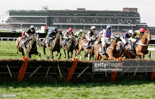 View of horses and riders about to jump over a fence with the Grandstand in the background in the Ballymore Properties Novices' Hurdle during the...