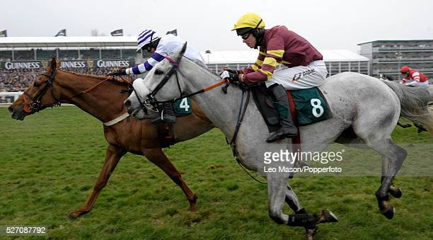 View of horses and riders competing in the 141st Year Of The National Hunt Chase Challenge Cup with eventual winner Chicago Grey ridden by Derek...