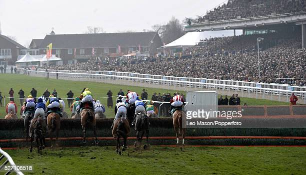 View of horses and riders competing in the Diamond Jubilee National Hunt Chase during the Cheltenham National Hunt Festival at Cheltenham Racecourse...