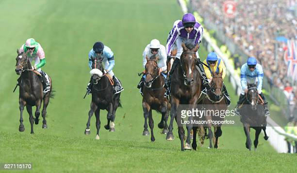 View of horses and riders competing in the Investec Derby race with eventual winner Camelot ridden by Joseph O'Brien leading by 5 lengths up the hill...