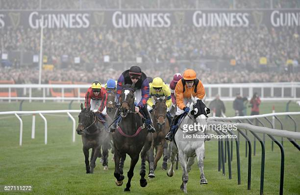 View of horses and riders competing in the Jewson Novices' Chase during the Cheltenham National Hunt Festival at Cheltenham Racecourse England on...