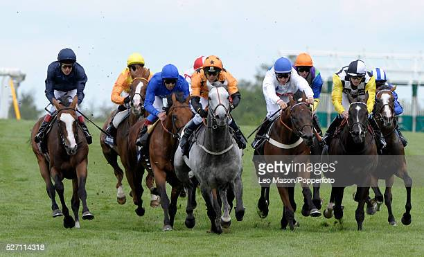 View of horses and riders competing in the Moet Hennessy Fillies' Stakes race during the 2010 Glorious Goodwood festival at Goodwood racecourse near...