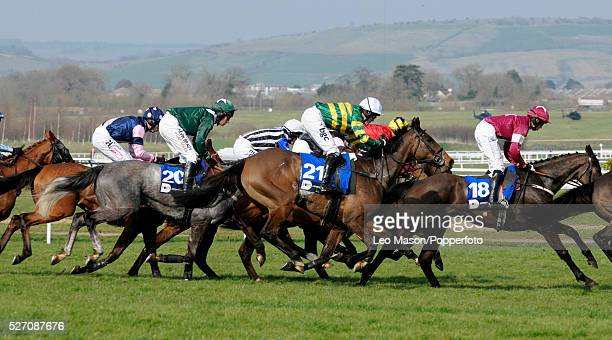 View of horses and riders competing in the Pertemps Final Handicap Hurdle race during the Cheltenham National Hunt Festival at Cheltenham Racecourse...