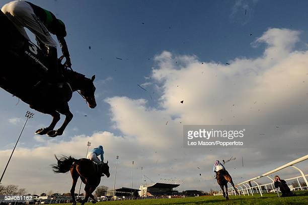 View of horses and riders competing in the Stanjamesuk.com Handicap Hurdle during the 2008 Stan James Christmas Festival at Kempton Park racecourse...