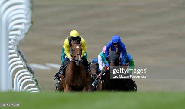 View of horses and riders competing in the TurfTV Summer Vase Handicap race during the 2010 Glorious Goodwood festival at Goodwood racecourse near...