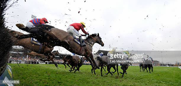 View of horses and riders competing in the William Hill Home of Betting Novices' Handicap chase during the Boxing Day meeting at Kempton Park...