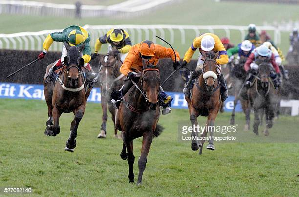 View of horses and riders competing in the William Hill Trophy Handicap Chase during the 2009 Cheltenham Festival in Cheltenham England on 10th March...