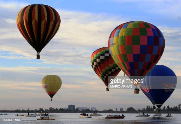 View of hot-air balloons during the XVIII International Balloon Festival in Leon, Guanajuato State, on November 18, 2018. - About 200 balloons from...