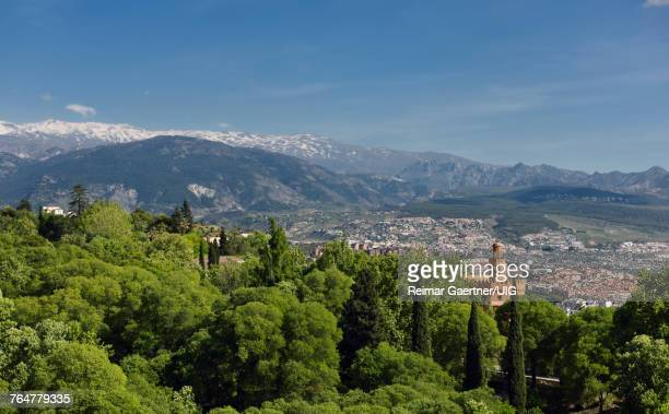 View of Hotel Alhambra Palace from Alcazaba and the snowy Sierra Nevada mountains Granada