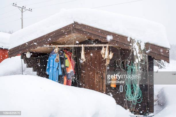 view of house with sport equipment - apres ski stock pictures, royalty-free photos & images
