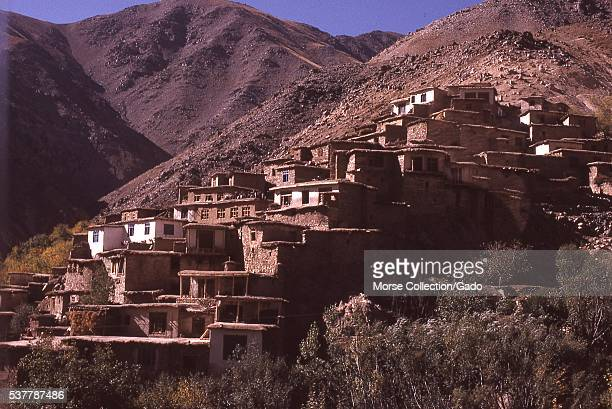 View of houses built into the hillside, in the town of Istalif, located northwest of Kabul, Afghanistan. November, 1973. .