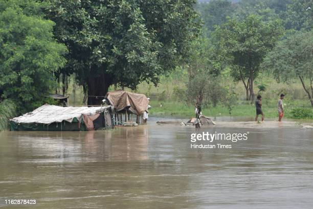 A view of houses submerged by the rising waters of the Yamuna River at Old Iron Bridge on August 20 2019 in New Delhi India Around 14000 people...