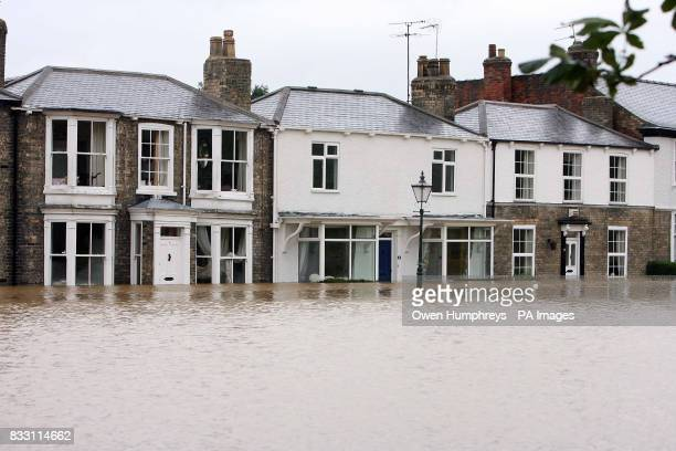 View of houses surrounded by water in Beverley North East Yorkshire after heavy rainfall caused flooding