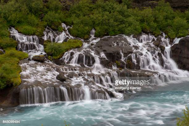 View of Hraunfossar in west Iceland are beautiful and unusual natural phenomena with clear cold springs of subterranean water seep through the lava...