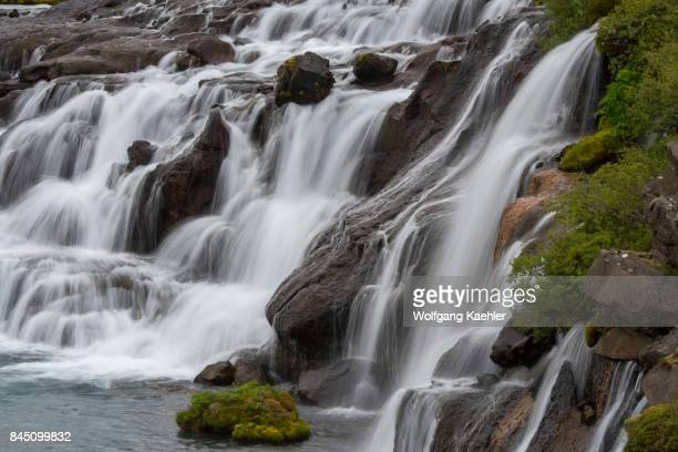 View of Hraunfossar Lava Falls in west Iceland are beautiful and unusual natural phenomena with clear cold springs of subterranean water seep through...