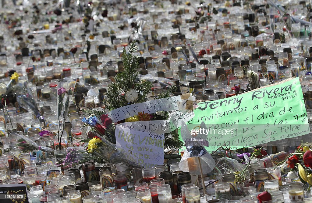 View of hundreds of candles are placed by fans in Monterrey Basilica in memory of singer Jenni Rivera on Tuesday December 11, 2012 in Monterrey, Mexico.