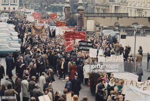 View of hundreds of Post Office workers marching through Lincoln's Inn Fields to Hyde Park in London to attend a mass strike rally for improved pay...