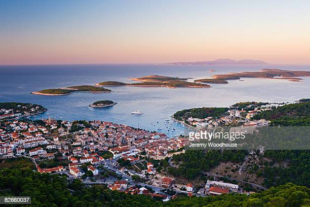 view of hvar town at dawn - hvar stock photos and pictures