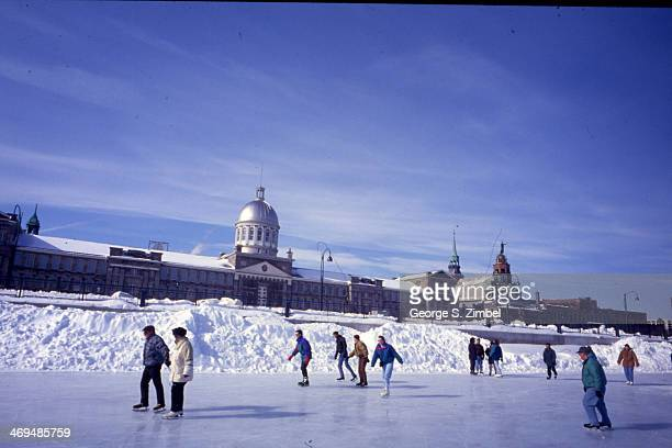View of ice skaters on the St. Lawrence River in front of the Bonsecours Market, Montreal, Quebec, Canada, 1990s.