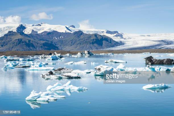 view of icebergs floating on jokulsarlon glacier lagoon, iceland - eismeer stock-fotos und bilder