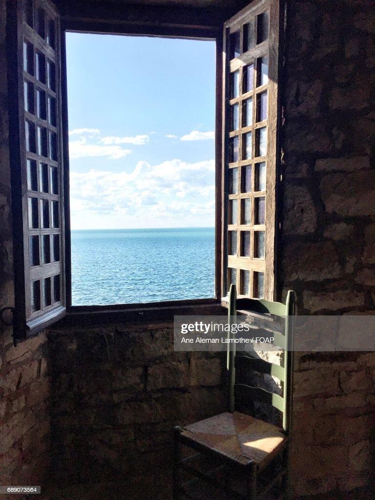 View of idyllic sea through window : Stock Photo
