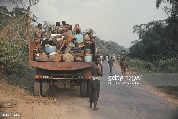 View of Igbo refugees pictured in trucks lined up on a road just outside the city of Owerri one of the former capitals of the Republic of Biafra...