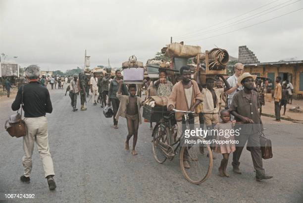 View of Igbo refugees pictured making their way along a road in to the city of Owerri one of the former capitals of the Republic of Biafra following...