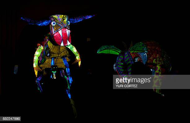 View of illuminated alebrijes coloured Mexican folk art sculptures representing fantastical creatures during the openenig ceremony of an exhibition...