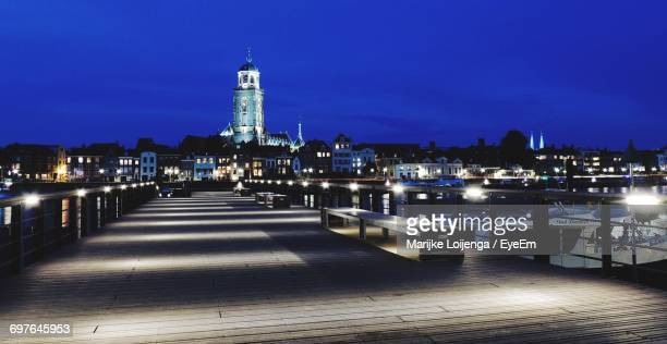 view of illuminated bridge at night - deventer stock photos and pictures