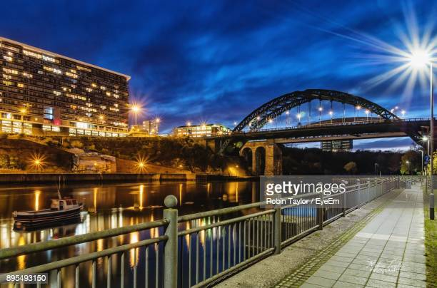 view of illuminated bridge at night - sunderland stock pictures, royalty-free photos & images