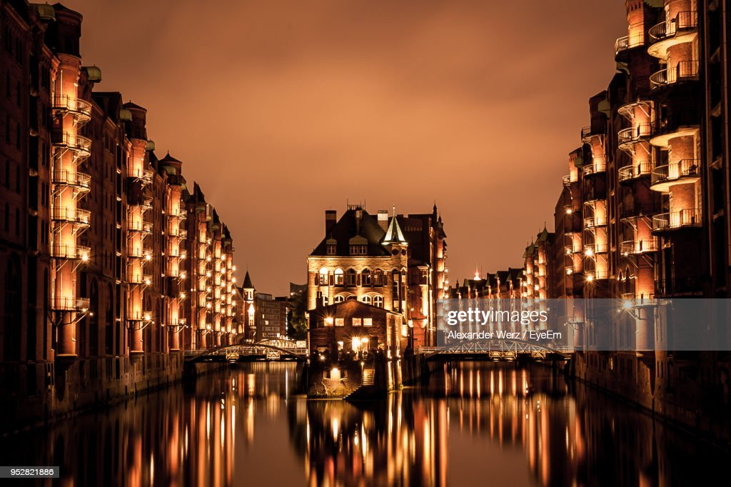 View Of Illuminated Buildings At Sunset : Stock Photo