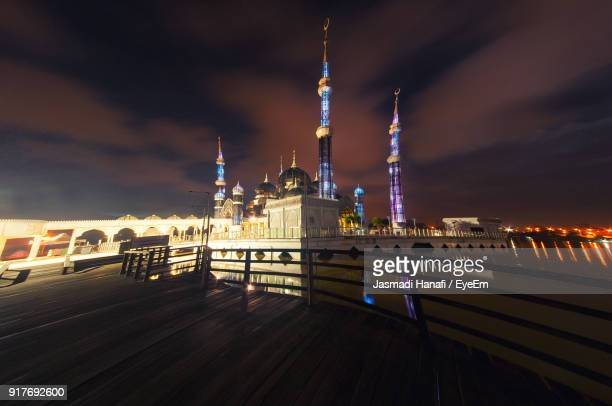 view of illuminated city at night - terengganu stock pictures, royalty-free photos & images
