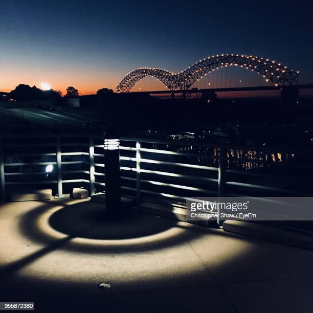 view of illuminated city at night - memphis bridge stock photos and pictures