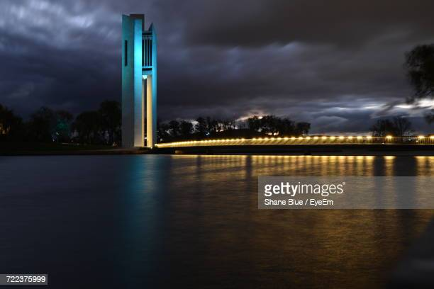 view of illuminated cityscape against cloudy sky - australian capital territory stock pictures, royalty-free photos & images