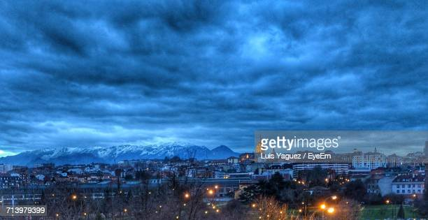 view of illuminated cityscape against dramatic sky - oviedo stock pictures, royalty-free photos & images