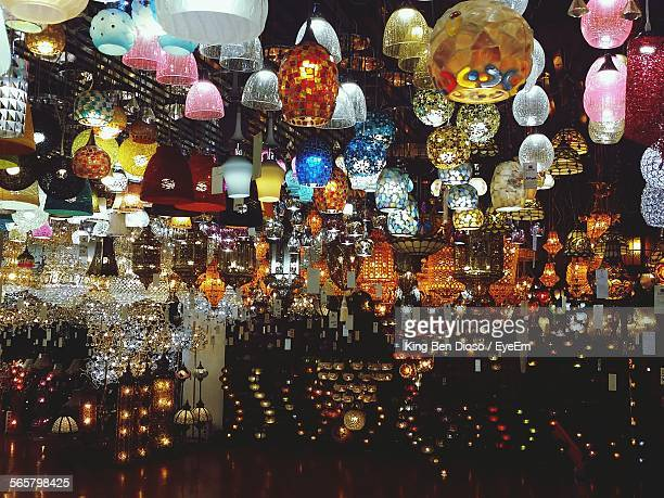 view of illuminated lamp shop - lamp stock photos and pictures