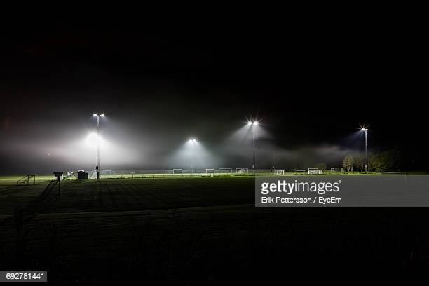 view of illuminated park at night - sport venue stock pictures, royalty-free photos & images