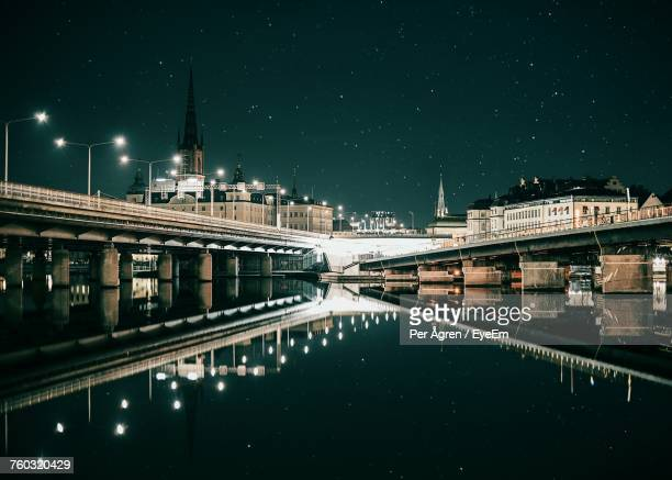 view of illuminated street light at night - stockholm stock pictures, royalty-free photos & images