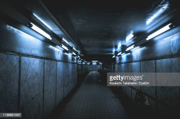 view of illuminated tunnel - fluorescent light stock pictures, royalty-free photos & images